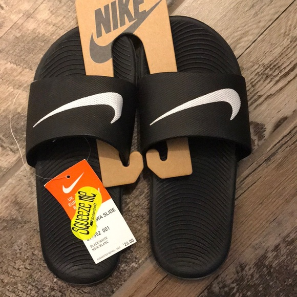 6a2bd55b5a0068 Nike Kawa slide Youth boys
